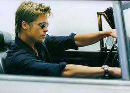 Brad Pitt sitting in a car