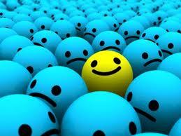 Yellow ball amongst blue balls