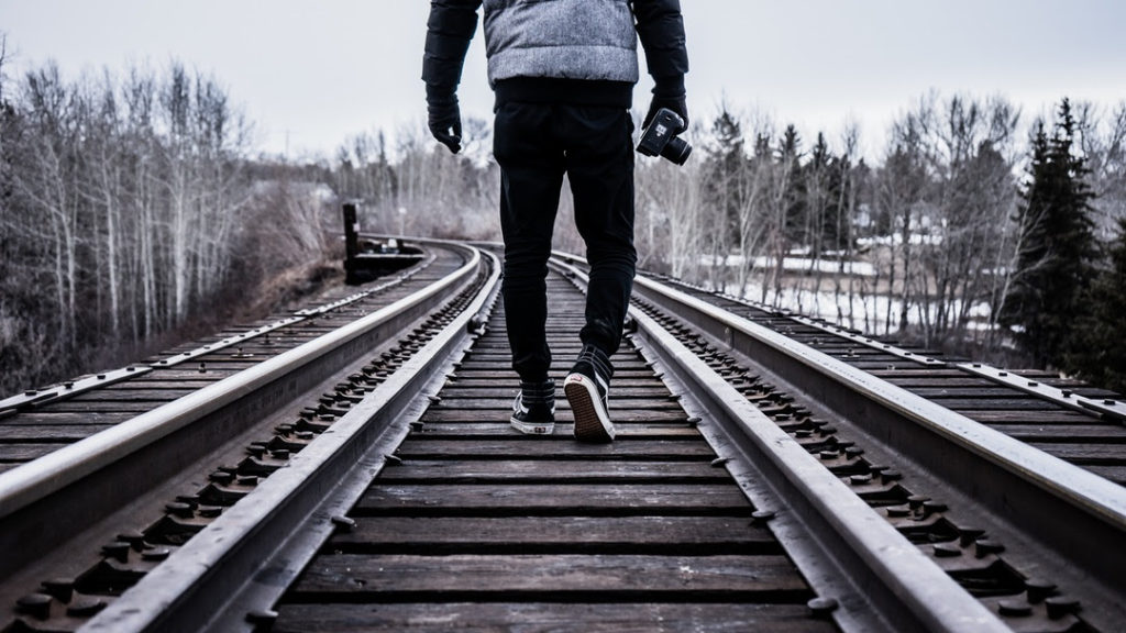 Photographer on a train line